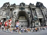 Athletes Yulamanova of Russia, Zhu and Bai of China, Tune and Mergia of Ethiopia pass by Berlin Cathedral as they run in the women's marathon at the world athletics championships in Berlin